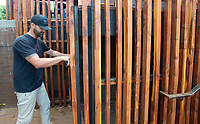 Jason Thomas of Farmington takes a measurement Monday Sept. 13, 2021 while working at Puritan Coffee & Beer in Fayetteville. Thomas is fabricating a metal gate for a storage area. Thomas does metal design, architectural steel, welding and fabrication through his business, Solo Fabrication. Visit nwaonline.com/210000914Daily/  (NWA Democrat-Gazette/J.T. Wampler)