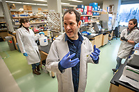 Biological sciences professor Eric Bortz discusses Corona viruses in his lab in UAA's ConocoPhillips Integrated Science Building.