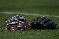 Baseball gloves sit in the outfield grass before a game between the Hagerstown Suns and Lexington Legends on May 22, 2015 at Whitaker Bank Ballpark in Lexington, Kentucky.  Lexington defeated Hagerstown 5-1.  (Mike Janes/Four Seam Images)
