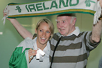 2/8/2010. Derval O'Rourke arrives back into Dublin Aiorport pictrured with fan Harry Gorman from Dublinl. European silver-medallist Derval O'Rourke has arrived home from Barcelona.O'Rourke finished second in the 100m hurdles on Saturday night to win her second European Athletics Championship silver medal. She was presented with her medal at the Olympic Stadium in Barcelona yesterday evening. Picture James Horan/Collins Photos.