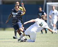 Jose Colchao #11 of Georgetown University avoids a tackle from Colin Givens #5 of Michigan State during an NCAA match at North Kehoe Field, Georgetown University on September 5 2010 in Washington D.C. Georgetown won 4-0.