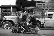 Child selling fruit in Bogota, Colombia - Child labor as seen around the world between 1979 and 1980 – Photographer Jean Pierre Laffont, touched by the suffering of child workers, chronicled their plight in 12 countries over the course of one year.  Laffont was awarded The World Press Award and Madeline Ross Award among many others for his work.