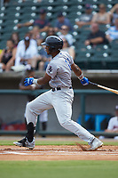 Lewin Diaz (11) of the Pensacola Blue Wahoos follows through on his swing against the Birmingham Barons at Regions Field on July 7, 2019 in Birmingham, Alabama. The Barons defeated the Blue Wahoos 6-5 in 10 innings. (Brian Westerholt/Four Seam Images)
