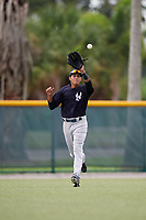 GCL Yankees East left fielder Alexander Santana (31) fields a ball in the outfield during the first game of a doubleheader against the GCL Pirates on July 31, 2018 at Pirate City Complex in Bradenton, Florida.  GCL Yankees East defeated GCL Pirates 2-0.  (Mike Janes/Four Seam Images)
