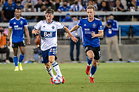 SAN JOSE, CA - AUGUST 13: Ryan Gauld #25 of the Vancouver Whitecaps is chased by Jackson Yueill #14 of the San Jose Earthquakes during a game between San Jose Earthquakes and Vancouver Whitecaps at PayPal Park on August 13, 2021 in San Jose, California.