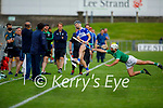St Brendan's Cian Hussesy gets his effort away as Mikey Boyle of Ballyduff bares down on him, in round 2 of the County Hurling Championship