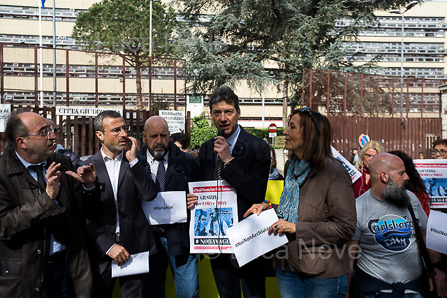 """Rome, 17/04/2018. Today, journalists and their representatives, organizations, and members of the public gathered outside the Rome's Courts of Justice in Piazzale Clodio to protest against the proposal of the preliminary investigations Judge to close and archive the investigations and the proceedings into the murder of the RAI TG3 (State broadcaster Rai's third channel) journalist Ilaria Alpi and her camera operator Miran Hrovatin, killed in circumstances still to be clarified on 20 March 1994 in Mogadishu, Somalia. The demonstration called """"Noi non archiviamo il caso di Ilaria Alpi e Miran Hrovatin"""" (We [don't close and] archive the case of Ilaria Alpi & Miran Hrovatin) was supported by Libera, LiberaInformazione, FNSI (Federazione Nazionale della Stampa Italiana - Italian Trade Union Of Journalists), Usigrai, TG3, Cnogm, Articolo21, Rete NoBavaglio, Amnesty International Italy. The demonstration was attended, amongst others, by: Luciana Alpi (Mother of Ilaria Alpi), Hashi Omar Hassan (The innocent man who was wrongfully sentenced and spent 17 years in prison for complicity in the murder of Italian journalist Ilaria Alpi), Paolo Borrometi (Sicilian journalist who has to live under police escort/protection because a Catania mafia clan planned to kill him due to his journalistic work and investigations about mafia and corruption – for more info please click here: https://bit.ly/2HckBvn). <br /> <br /> For more info about Alpi-Hrovatin case please click here: http://www.ilariaalpi.it/ & https://bit.ly/2Hu0Y5o (In this article you can also find news about Hashi Omar Hassan) & https://bit.ly/2HN2z4c (Ilaria Alpi, Wikipedia) & https://bit.ly/2qGeeui (Miran Hrovatin, Wikipedia) & https://bit.ly/2Hg1yk4 (The Herald, Scotland) & https://bit.ly/2HbSSeg (ANSA – 17.04.18) <br /> <br /> For a video of the event by Radio Radicale please click here: https://t.co/Buu53Zxwkf"""