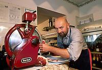 """- ypical restaurant """" da Ivan """", the owner  with ancient  ham slicing machine <br /> <br /> - ristorante tipico """"da Ivan"""", il titolare con una antica affettatrice per il prosciutto"""