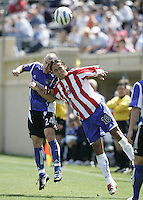 9 April 2005:  Wade Barrett of Earthquakes battles for the ball in the air against Hector Cuadros of Chivas USA at Spartan Stadium in San Jose, California.   San Jose Earthquakes tied Chivas USA, 3-3.   Credit: Michael Pimentel / ISI