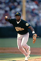 Miguel Tejada #4 of the Oakland Athletics during a 2000 season MLB game against the  Los Angeles Angels at Angel Stadium in Anaheim, California. (Larry Goren/Four Seam Images)