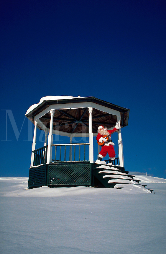 Rock n' Roll Santa playing guitar in the snow