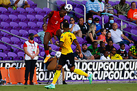 July 16th 2021; Orlando, Florida, USA; Guadeloupe defender Kelly Irep heads the ball clear during the Concacaf Gold Cup match between Guadeloupe and Jamaica on July 16, 2021 at Exploria Stadium in Orlando, Fl.