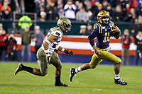 Philadelphia, PA - December 14, 2019:     Navy Midshipmen quarterback Malcolm Perry (10) runs past a Army Black Knights defender during the 120th game between Army vs Navy at Lincoln Financial Field in Philadelphia, PA. (Photo by Elliott Brown/Media Images International)