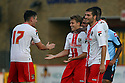 Luke Freeman of Stevenage (2nd l) is congratulated after scoring thier second goal<br />   Stevenage v QPR XI - Pre-season friendly - Lamex Stadium, Stevenage - 16th July, 2013<br />  © Kevin Coleman 2013<br />  <br /> <br />  <br />  <br /> <br />  <br />  © Kevin Coleman 2013