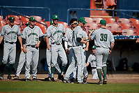 Dartmouth Big Green pitcher Alec Vaules (39) is greeted by teammates at the dugout during a game against the Bradley Braves on March 21, 2019 at Chain of Lakes Stadium in Winter Haven, Florida.  Bradley defeated Dartmouth 6-3.  (Mike Janes/Four Seam Images)