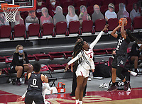 Arkansas' Erynn Barnum tries to block a shot by Texas A&M's Aaliyah Wilson Sunday Jan. 10, 2021 at Bud Walton Arena in Fayetteville. Arkansas lost 74-73. Visit nwaonline.com/210111Daily/ and nwadg.com/photos. (NWA Democrat-Gazette/J.T. Wampler)