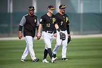 Pittsburgh Pirates outfielder Corey Dickerson (12) walks in after a drill with coach Kimera Bartee (18) and Garth Brooks (7) during the teams first Spring Training practice on February 18, 2019 at Pirate City in Bradenton, Florida.  (Mike Janes/Four Seam Images)