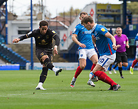 Milton Keynes Dons' Sam Nombe (left) strikes to ball at goal but is blocked by Portsmouth's Sean Raggett (right) <br /> <br /> Photographer David Horton/CameraSport<br /> <br /> The EFL Sky Bet League One - Portsmouth v Milton Keynes Dons - Saturday 10th October 2020 - Fratton Park - Portsmouth<br /> <br /> World Copyright © 2020 CameraSport. All rights reserved. 43 Linden Ave. Countesthorpe. Leicester. England. LE8 5PG - Tel: +44 (0) 116 277 4147 - admin@camerasport.com - www.camerasport.com