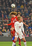 Cardiff - Wales - UK - 16th November 2018 - UEFA Nations League 2019 :<br />Wales v Denmark at the Cardiff City Stadium :<br />Ethan Ampadu of Wales beats Kasper Dolberg of Denmark to the high ball in the second half sending him flying to the ground.