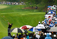 Tiger Woods hits a tee shot in the rain during the 2007 Wachovia Championships at Quail Hollow Country Club in Charlotte, NC.