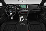 Stock photo of straight dashboard view of 2017 BMW M6 - 2 Door Convertible Dashboard