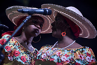 CALI - COLOMBIA. 14-08-2019: El grupo de músca autóctona Bombo Negro hace su presentación durante el primer día del XXIII Festival de Música del Pacífico Petronio Alvarez 2019 el festival cultural afro más importante de Latinoamérica y se lleva acabo entre el 14 y el 19 de agosto de 2019 en la ciudad de Cali. / The group Bombo Negro makes its performance of autochthonous music during the XXII Pacific Music Festival Petronio Alvarez 2019 that is the most important afro descendant cultural festival of Latin America and takes place between August 14 and 19, 2019, in Cali city. Photo: VizzorImage/ Gabriel Aponte / Staff