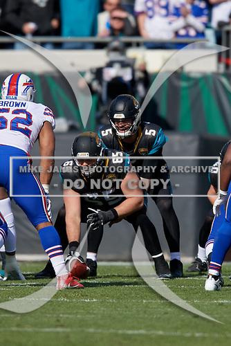 Jacksonville Jaguars quarterback Blake Bortles (5) under center Brandon Linder (65) during an NFL Wild-Card football game against the Buffalo Bills, Sunday, January 7, 2018, in Jacksonville, Fla.  (Mike Janes Photography)