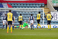 20th February 2021; Dens Park, Dundee, Scotland; Scottish Championship Football, Dundee FC versus Queen of the South; Ayo Obileye of Queen of the South scores the opening goal to put his side 1-0 ahead from the penalty spot in the 1st minute