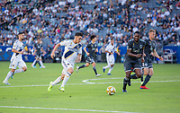 CARSON, CA - SEPTEMBER 29: Cristian Pavon #10 of the Los Angeles Galaxy moves with the ball during a game between Vancouver Whitecaps and Los Angeles Galaxy at Dignity Health Sports Park on September 29, 2019 in Carson, California.