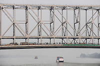 INDIA Westbengal, Kolkata, ferry boat on Hooghli river and Howrah bridge / INDIEN, Westbengalen, Kolkata, Boot auf dem Hugli Fluss und Howrah Bruecke