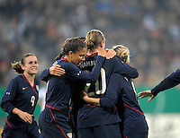Abby Wambach (20) celebrates with teammates. US Women's National Team defeated Germany 1-0 at Impuls Arena in Augsburg, Germany on October 27, 2009.