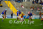 Lixnaws Gerard Stackpoole and Jeremy McKenna double mark Kilmoyley's Daniel Collins as they tussle for possession in round 2 of the County Senior hurling championship