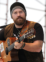 "PEMBROKE PINES, FL - JANUARY 29: Country music artist, Zac Brown performs during the 27th annual Kiss Country Chili Cookoff and Music Festival.  Zac Brown Band is an American country music band based in Atlanta, Georgia. The lineup consists of Zac Brown (vocals, guitar, bass guitar, percussion), Jimmy De Martini (fiddle, vocals), John Driskell Hopkins (bass guitar, guitar, vocals), Coy Bowles (guitar, keyboards), Chris Fryar (drums) and Clay Cook (guitar, keyboards, mandolin, steel guitar, vocals). The band has toured throughout the United States, including a slot on the 2009 and 2010 Bonnaroo Music Festival. They have also recorded four studio albums, and charted eight Number One singles on the Billboard country charts: ""Chicken Fried"", ""Toes"", ""Highway 20 Ride"", ""Free"", ""As She's Walking Away"", ""Colder Weather"", ""Knee Deep"" and ""Keep Me In Mind"", in addition to the single ""Whatever It Is,"" which peaked at number 2 on the same chart..  on January 29, 2006 in Pembroke Pines, Florida.  <br /> <br /> People:  Zac Brown<br /> <br /> Transmission Ref:  FLXX<br /> <br /> Must call if interested<br /> Michael Storms<br /> Storms Media Group Inc.<br /> 305-632-3400 - Cell<br /> 305-513-5783 - Fax<br /> MikeStorm@aol.com<br /> www.StormsMediaGroup.com"