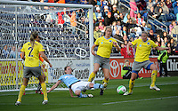 Chicago forward Kosovare Asllani (10) attempts to play the ball while surrounded by Philadelphia defenders Heather Mitts, (2), Allison Falk (3), and Sara Larsson (7).  The Philadelphia Independence defeated the Chicago Red Stars 1-0 at Toyota Park in Bridgeview, IL on May 15, 2010.