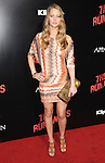 Jennifer Lawrence  at APPARITION'S L.A. Premiere of The Runaways held at The Arclight Cinerama Dome in Hollywood, California on March 11,2010                                                                   Copyright 2010 DVS / RockinExposures..