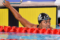 Caroline Puamau of FIJ looks at the clock after competing in 50 meter backstroke final during Commonwealth Games Swimming, Monday, July 28, 2014 in Glasgow, United Kingdom. (Mo Khursheed/TFV Media via AP Images)