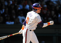 Clemson right fielder Kyle Parker (11) hits during a game between the Clemson Tigers and South Carolina Gamecocks Saturday, March 6, 2010, at Fluor Field at the West End in Greenville, S.C. Parker is ranked No. 73 prospect in the nation by Baseball America. Photo by: Tom Priddy/Four Seam Images