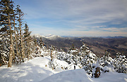 January 2014 - Snow covered mountains from Mount Tecumseh in Waterville Valley, New Hampshire. Illegal tree cutting has improved the view from the summit. Forest Service did not approve the cutting.