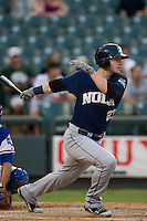 New Orleans Zephyrs first baseman Joe Mahoney (23) follows through on his swing during the Pacific Coast League baseball game against the Round Rock Express on June 30, 2013 at the Dell Diamond in Round Rock, Texas. Round Rock defeated New Orleans 5-1. (Andrew Woolley/Four Seam Images)