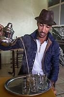 Essaouira, Morocco.  Hafid, a Berber, Pouring Tea.