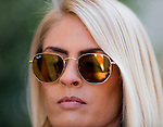 HALLANDALE BEACH, FL - JAN 28: A reflection of a gentleman in a woman's sunglasses during Pegasus World Cup Invitational Day at Gulfstream Park Race Course on January 28, 2017 in Hallandale Beach, Florida. (Photo by Doug DeFelice/Eclipse Sportswire/Getty Images)