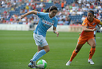 Chicago Red Stars forward Karen Carney (14) drives against Sky Blue FC midfielder Kacey White (8).  The  Chicago Red Stars defeated the Sky Blue FC 2-0 at Toyota Park in Bridgeview, IL on July 10, 2010.
