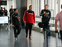 Wednesday 28 August 2013<br /> Pictured L-R: Leon Britton, Lee Trundle and Garry Monk at Cardiff Airport.<br /> Re: Swansea City FC players and staff en route for their UEFA Europa League, play off round, 2nd leg, against Petrolul Ploiesti in Romania.