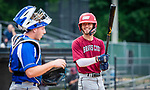 WATERBURY, CT 071221JS20  Brass City Bombers' John Greene (8) gives a smile to the home plate umpire, Jim Shove, during their Connecticut Collegiate Baseball League game against the Wallingford Silver Storm Monday at Municipal Stadium in Waterbury. <br />  Jim Shannon Republican American