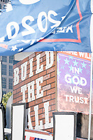 "Trump flags and signs reading ""Build the Wall"" and ""In God We Trust"" are seen on the ""Trump Unity Bridge"" before the Straight Pride Parade in Boston, Massachusetts, on Sat., August 31, 2019. The parade was organized in reaction to LGBTQ Pride month activities by an organization called Super Happy Fun America."