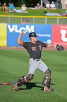 Max Stassi (12) of the Fresno Grizzlies warms up in the outfield before the game against the Salt Lake Bees in Pacific Coast League action at Smith's Ballpark on June 13, 2015 in Salt Lake City, Utah.  (Stephen Smith/Four Seam Images)