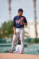 GCL Twins relief pitcher Junior Navas (45) looks in for the sign during the first game of a doubleheader against the GCL Orioles on August 1, 2018 at CenturyLink Sports Complex Fields in Fort Myers, Florida.  GCL Twins defeated GCL Orioles 7-6 in the completion of a suspended game originally started on July 31st, 2018.  (Mike Janes/Four Seam Images)