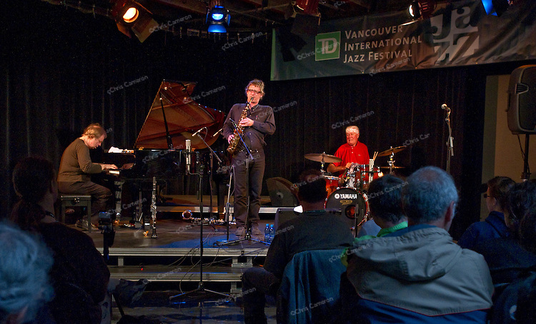 Paul Plimley, Frank Gratkowski and Han Bennink play at the CBC Radio Studio.