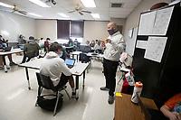 J Keith (CQ) teaches 8th grade social studies Thursday Dec. 17, 2020 at Lincoln Middle School. Visit nwaonline.com/201227Daily/ and nwadg.com/photos. (NWA Democrat-Gazette/J.T. Wampler)