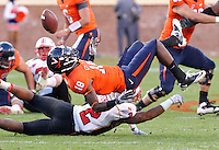 Nov 13, 2010; Charlottesville, VA, USA;  Virginia Cavaliers wide receiver Kris Burd (18) looses control of the ball next to Maryland Terrapins defensive back Antwine Perez (2) during the 1st half of the game at Scott Stadium.  Mandatory Credit: Andrew Shurtleff